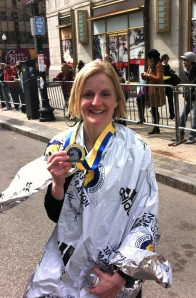 Jennifer Anderson poses just after finishing the Boston Marathon. The bombs exploded just minutes after this picture was taken.