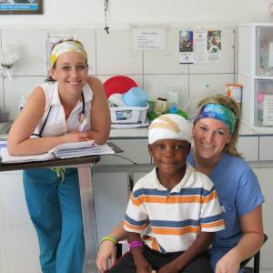 Angelee, left, and Heather, right, serve a young patient.
