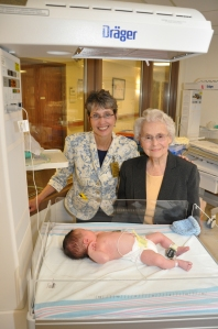 Laura Noren and her mother, Ann, visit Boone Hospital Center's nursery.